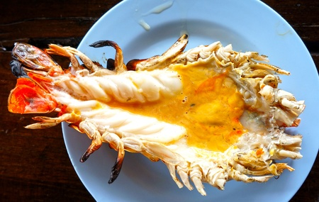 Thai most favorite food, grilled giant freshwater prawn cut in half and served photo