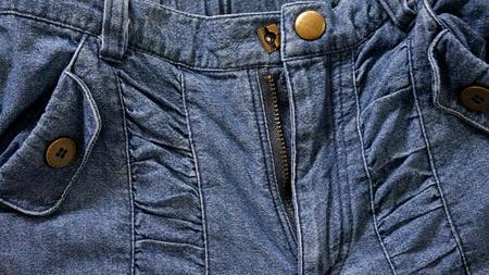 jeans texture: Blue jeans textura con el bolsillo y cremallera Foto de archivo