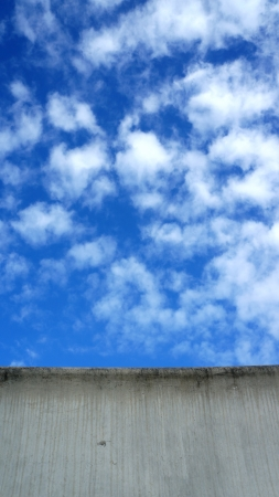 barrier wall on a highway against blue sky photo