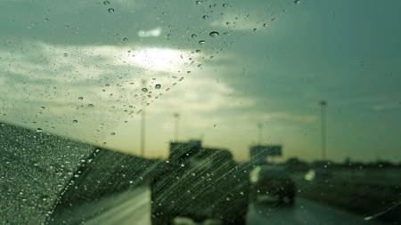 driving in rain (evening road view) photo