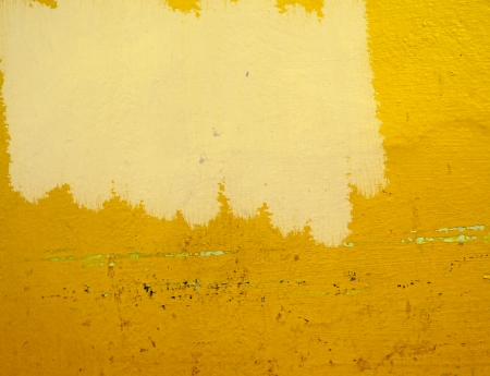unfinished painting yellow wall photo