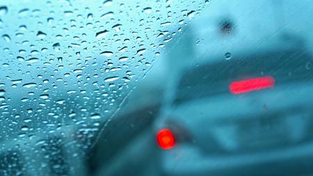 rain window: rain drops on car glass, focus on raindrops Stock Photo