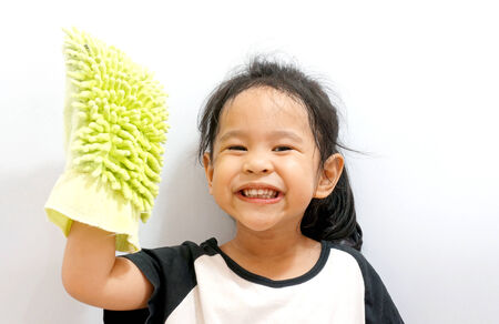 Little girl cleaning isolated on white background photo