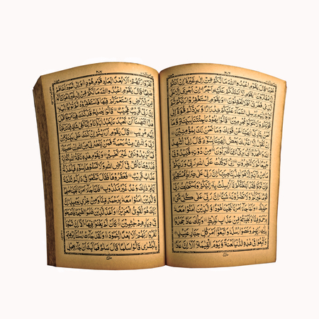 The Holy Old Book Of Quran Isolated On White photo