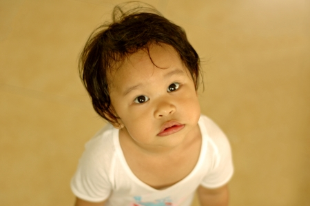 Little kid with curious eyes photo