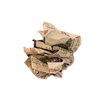 scrunched: screwed up piece of newspaper over a white background