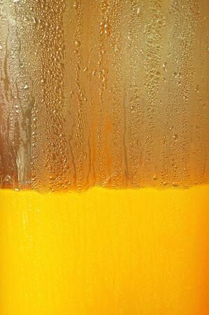 Orange juice in dispenser photo