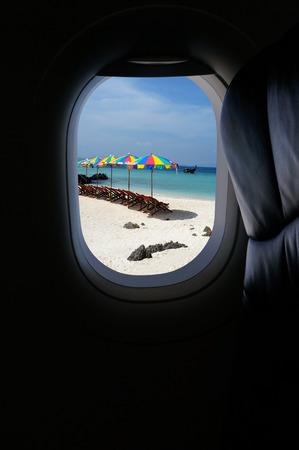 holiday destination: Approaching island holiday destination, jet plane window sky view Stock Photo