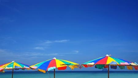 colorful umbrella beach on sunny summer day photo
