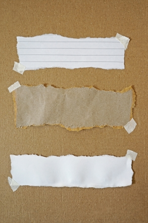 collection of various paper pieces on brown paper background photo