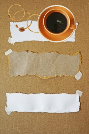 Coffee cup with stains on paper background photo