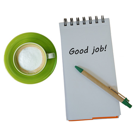drink me: Text good job on note book with pen and coffee cup isolated on white background Stock Photo