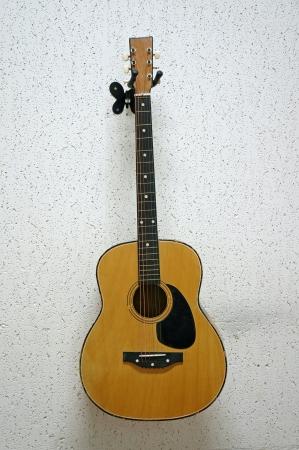 resonating: classic guitars hanging on wall