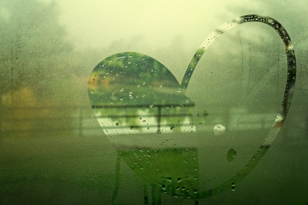 drawn heart on the wet glass