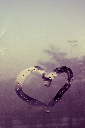 drawn heart on the wet glass photo