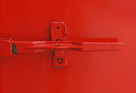 Red door with closed padlock photo