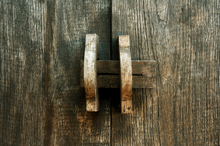 Obsolete wooden door bolt, Thai tradition photo