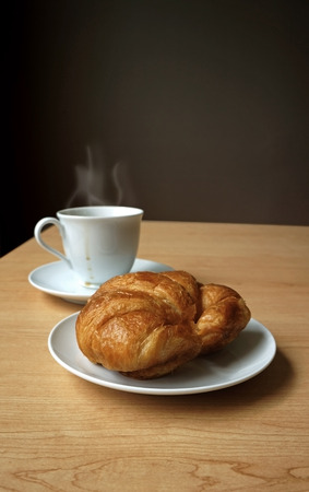 Hot coffee with croissant photo