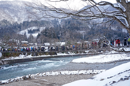 gifu: SHIRAKAWA, JAPAN-March 8  Tourists visit old village on MARCH 8, 2014 in Shirakawa-go,Japan  Shirakawa is one of most popular attractions in Japan, listed as UNESCO World Heritage Site since 1995