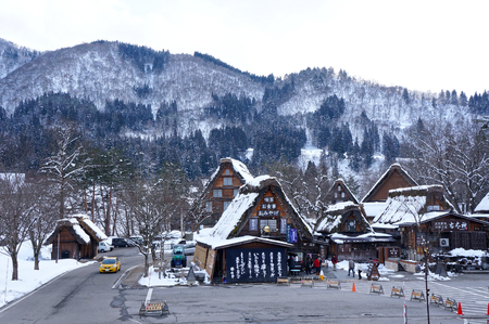 gassho zukuri: SHIRAKAWA,JAPAN-MARCH 8 Tourists visit old village on MARCH 8, 2014 in Shirakawa-go, Japan  Shirakawa is one of most popular attractions in Japan, listed as UNESCO World Heritage Site since 1995 Editorial