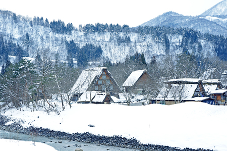 gassho zukuri: SHIRAKAWA,JAPAN-MAR CH 8 Tourists visit old village on MARCH 8, 2014 in Shirakawa-go, Japan  Shirakawa is one of most popular attractions in Japan, listed as UNESCO World Heritage Site since 1995