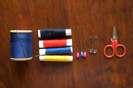 Sewing items with a vintage feel, thread, antique scissors, pins and buttons photo