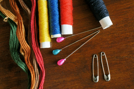 Sewing items with a vintage feel, thread, antique, pins and buttons photo