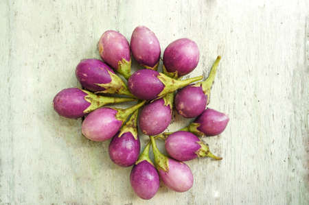 top view of purple tomatoes on wooden table