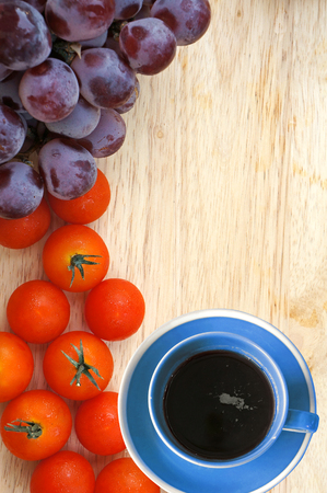 Hot coffee, grape and tomato. Frame design. photo