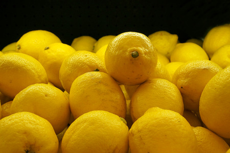 Colorful Display Of Lemons In Market