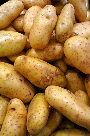 Lots of potatoes in supermarket photo