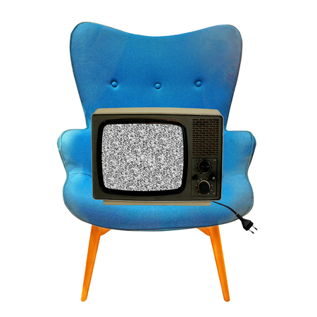 vintage tv on a blue chair photo