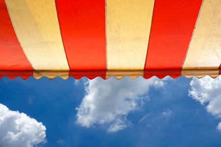 Awning over bright sunny blue sky Stockfoto