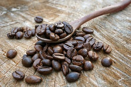 brewed: Coffee beans on an old wooden background Stock Photo