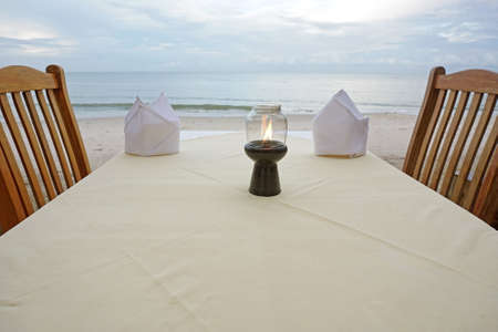 Table set up on the terrace of a restaurant by the sea photo