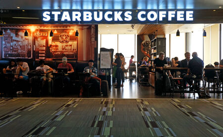 BANGKOK - MARCH 3: Starbucks Coffee coffeehouse on March 3, 2014 in Bangkok Donmuang Airport. Starbucks is the largest coffeehouse company in the world, with 19,435 stores in 58 countries (2012). Stock Photo - 29477585