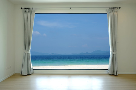 Opened door, sea view background photo