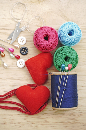 sewing kit, needles, thread and measuring tape photo