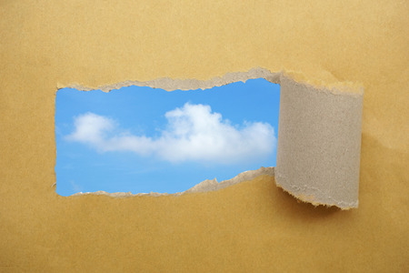 Torn envelope open to sky  concept and idea  photo