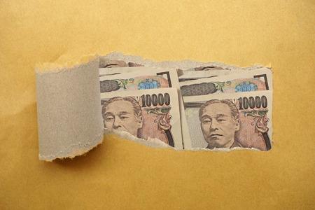 Torn envelope full of Japan Yen photo