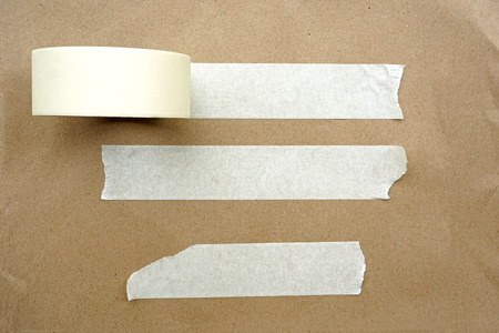 Brown paper with white tape for background photo