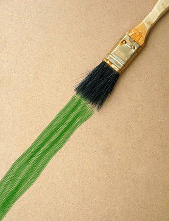 Brush painting on wooden background Stock Photo