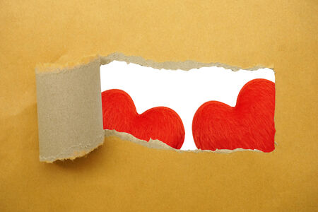 heart under: Red heart under torn paper strip Stock Photo