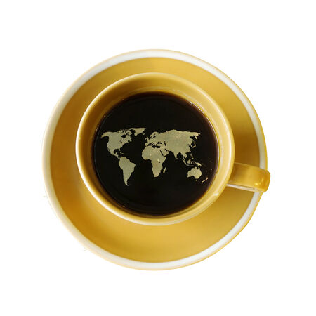 world map on cup of fresh espresso isolate  photo