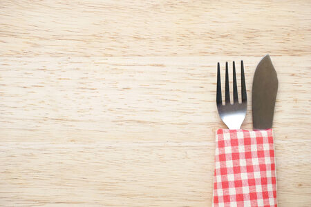 knife and fork on table photo