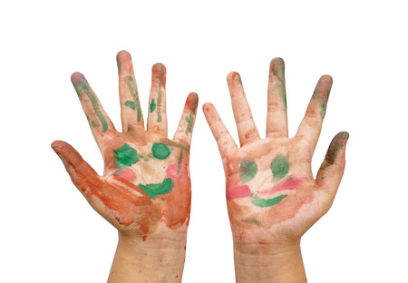 painted colorful smile on hand on a white background photo