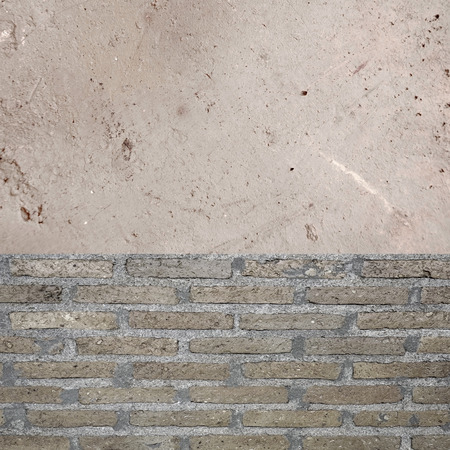 amaged: Gray brick and stained cement wall Stock Photo