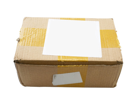 battered cardboard box isolated on white background photo