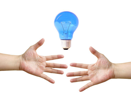 Hands and bulb light isolated on white background photo