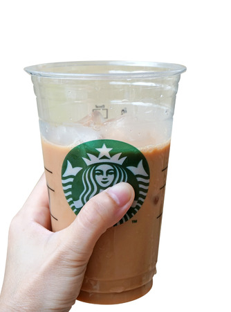Bangkok ,Thailand-September 7 : Glass of Starbuck Coffee Beverages on hand isolate on white background, 7 September 2014. Starbucks Coffee (Thailand) Co., Ltd. was founded in Thailand since July 1998. Editorial